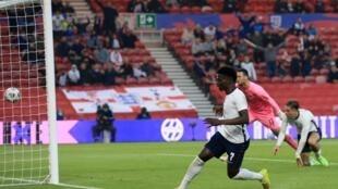 Le défenseur anglais Bukayo Saka buteur lors du match amical contre l'Autriche, à Middlesbrough, le 2 juin 2021