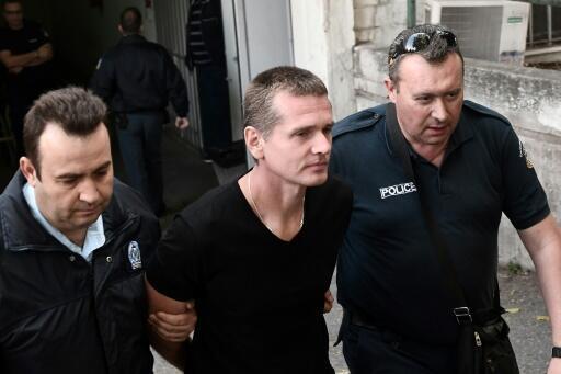 Russian Alexander Vinnik, centre, has been held in custody since his arrest last year on suspicion of money laundering