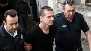 Russian Alexander Vinnik, centre, has been held in custody since his arrest last year on suspicion of money laundering