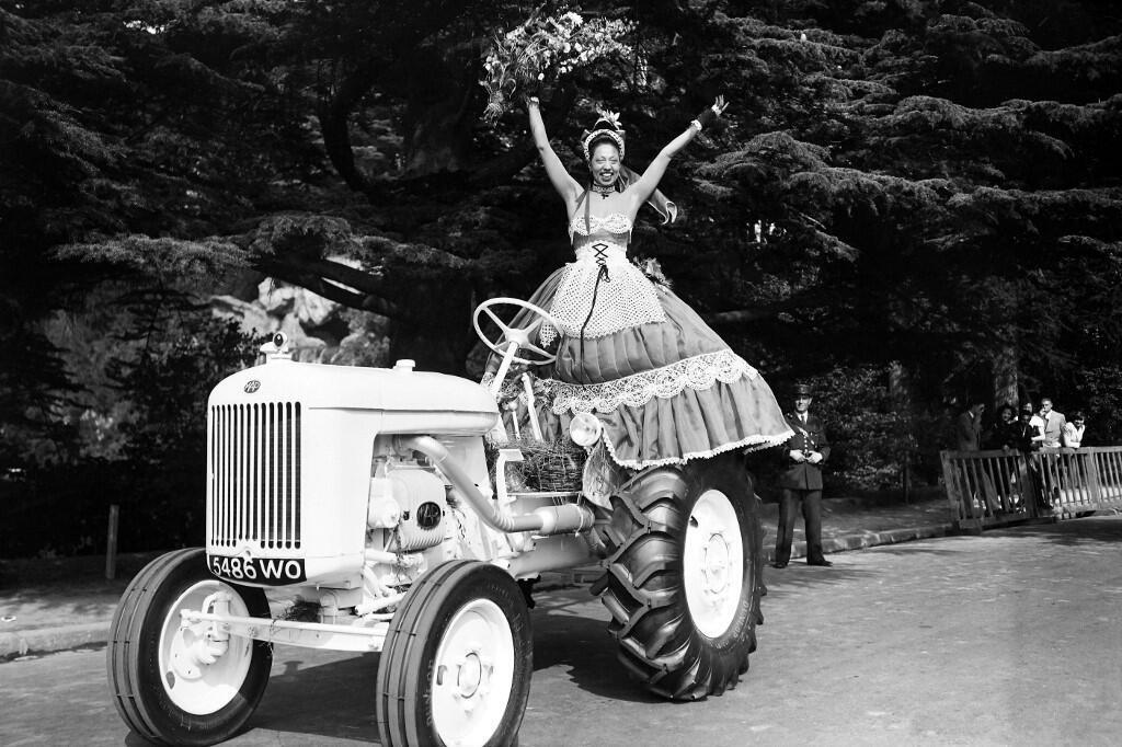 Joséphine Baker poses during the Concours d'Elegance Automobile at the Bois de Boulogne waterfall, near Paris, on June 23, 1949.
