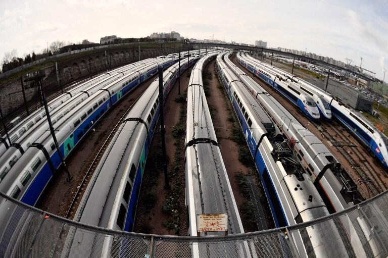 In this file photo taken on April 4, 2018, TGV high speed trains stand on tracks outside the Gare de Lyon train station in Paris, on the second day of three months of rolling rail strikes by the staff of French public railways service SNCF.