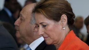 French Environment and Energy Minister Segolene Royal (R) withFrench Foreign Affairs Minister Laurent Fabius