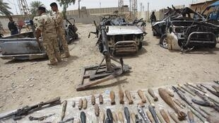 Iraqi security forces display weapons captured from the Islamic State armed gtoup