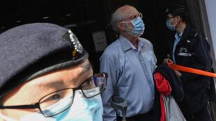 El abogado estadounidense John Clancey en el momento de ser detenido en Hong Kong el 6 de enero de 2021