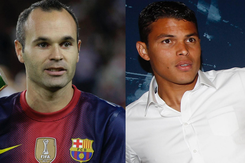 O meia Andrés Iniesta, do Barcelona e o brasileiro Thiago Silva, novo contratado do Paris Saint Germain