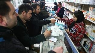 Iranians scramble to buy protective masks and sanitisers in Tehran.