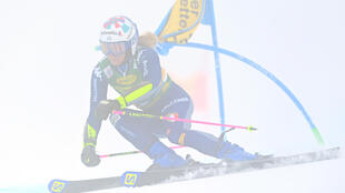 Italian Marta Bassino took a slender lead in the first run of the World Cup season opener at a foggy Soelden