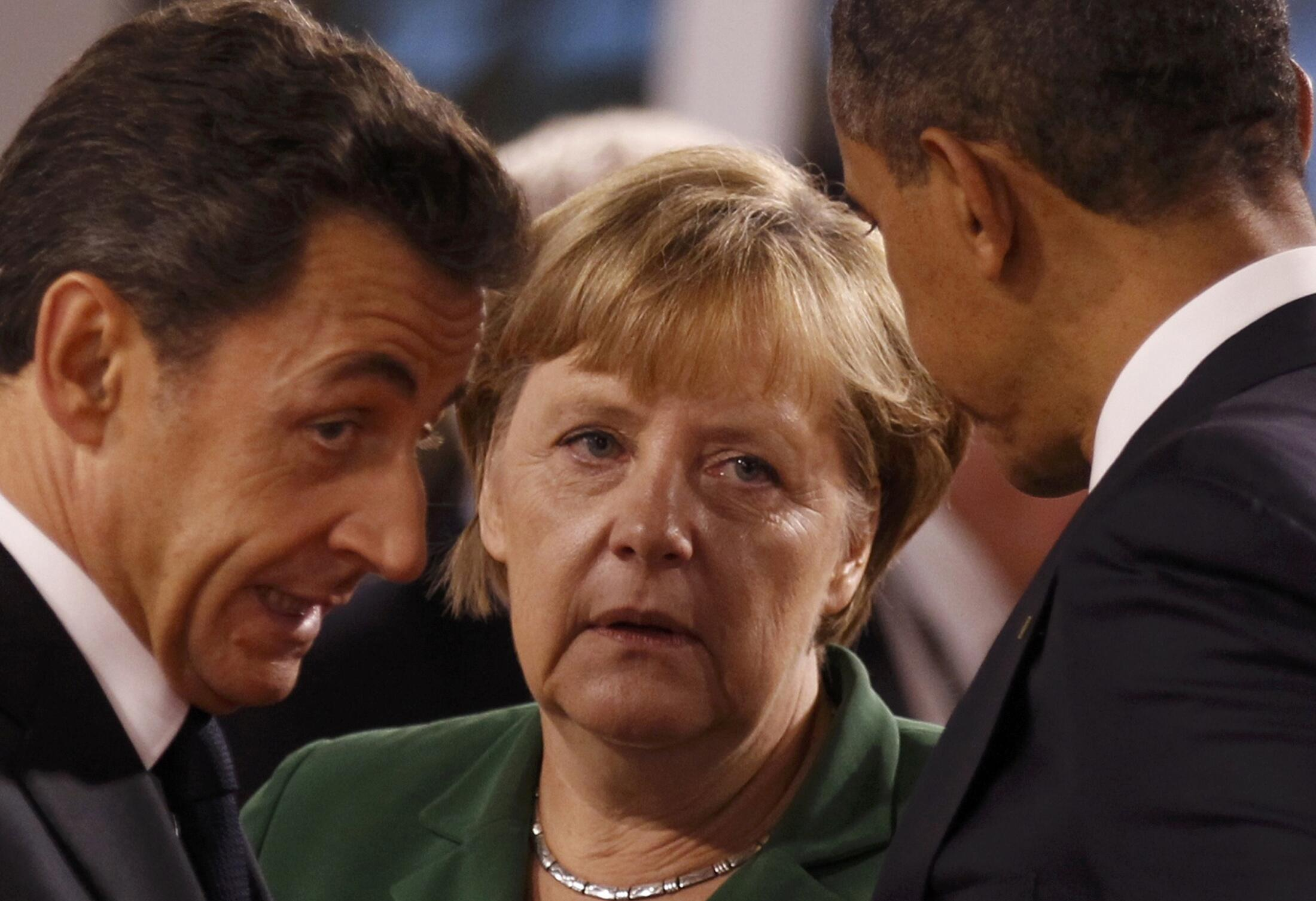 Bossyboots? Nicolas Sarkozy (L), Angela Merkel (C) and  Barack Obama (R) at the G20 in Nice this month