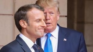 French President Emmanuel Macron and U.S. President Donald Trump on the sidelines of D-Day commemorations, June 6, 2019