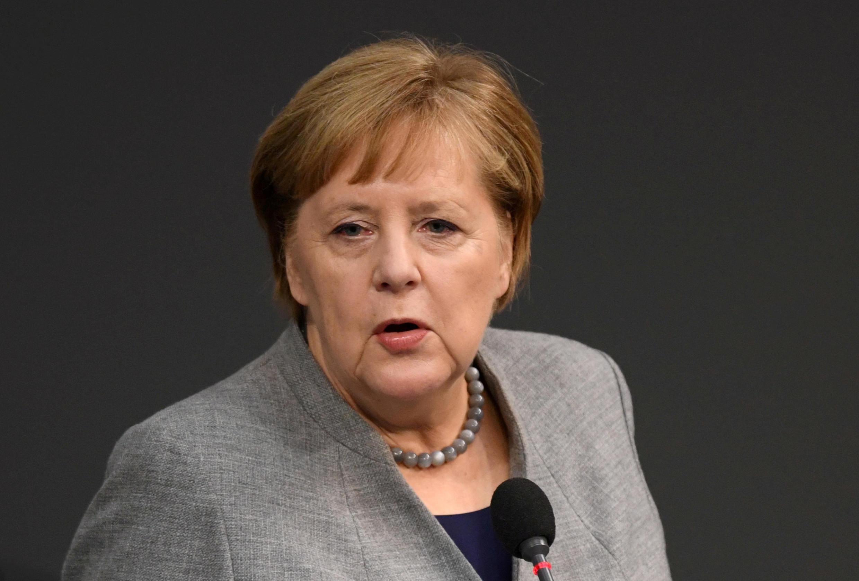 德國總理默克爾12月18日在議會