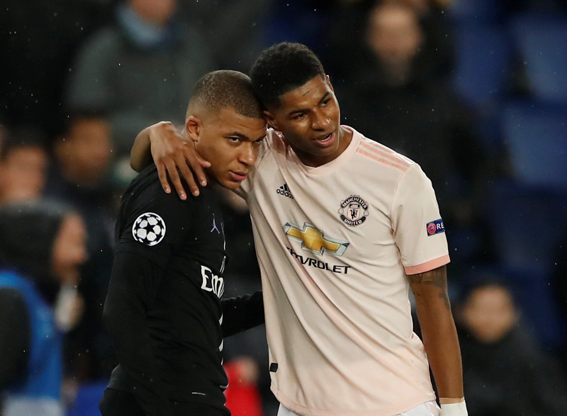 Manchester United's Marcus Rashford (right) consoles PSG's Kylian Mbappé after the second leg of the last 16 clash between the sides.