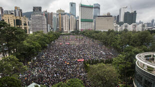 Protesters gather for a rally in Victoria Park in Hong Kong in the latest opposition to a planned extradition law that has since morphed into a wider call for democratic rights, 18 August 2019.