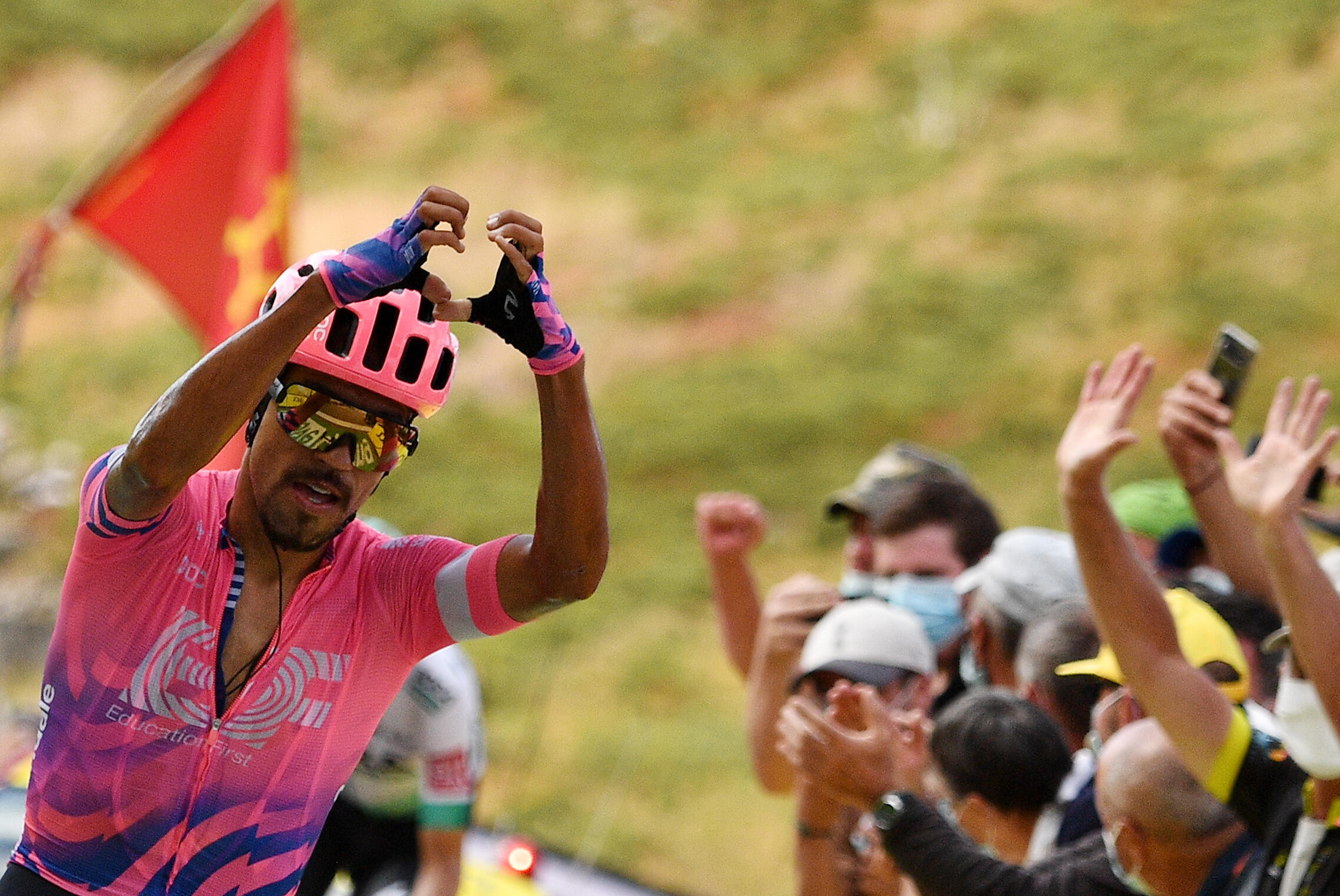 Stage winner Team Education First rider Colombia's Daniel Martinez on the summit of Puy Mary on Friday