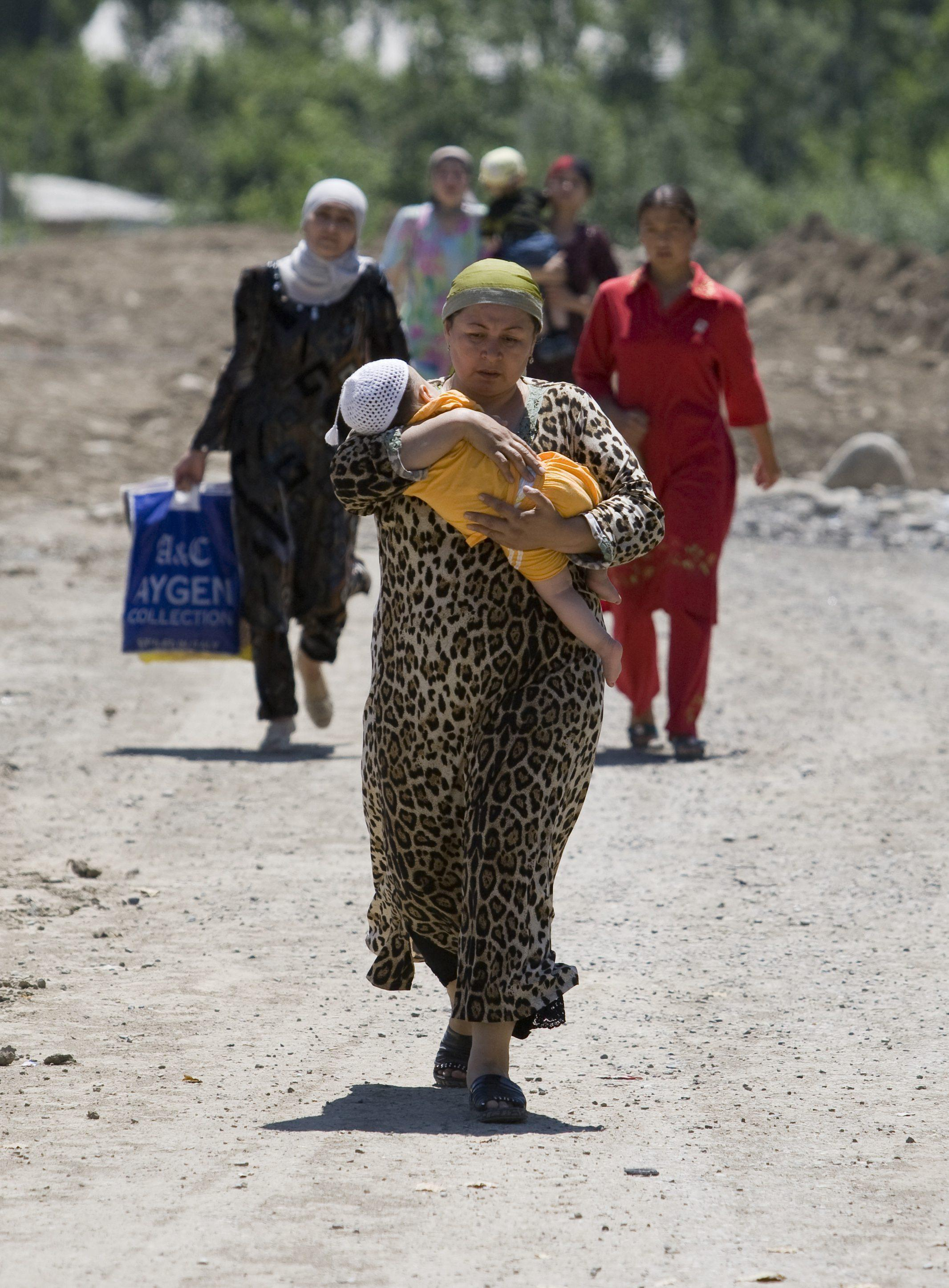Ethnic Uzbek women who fled from southern Kyrgyzstan in the village of Yorkishlak