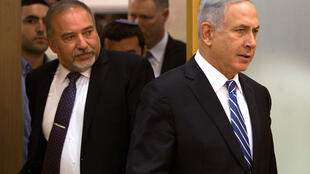 A file picture taken on May 30, 2016 shows Israeli Prime Minister Benjamin Netanyahu (R) and Defence Minister Avigdor Lieberman (L) arriving for a joint press conference at the Knesset.