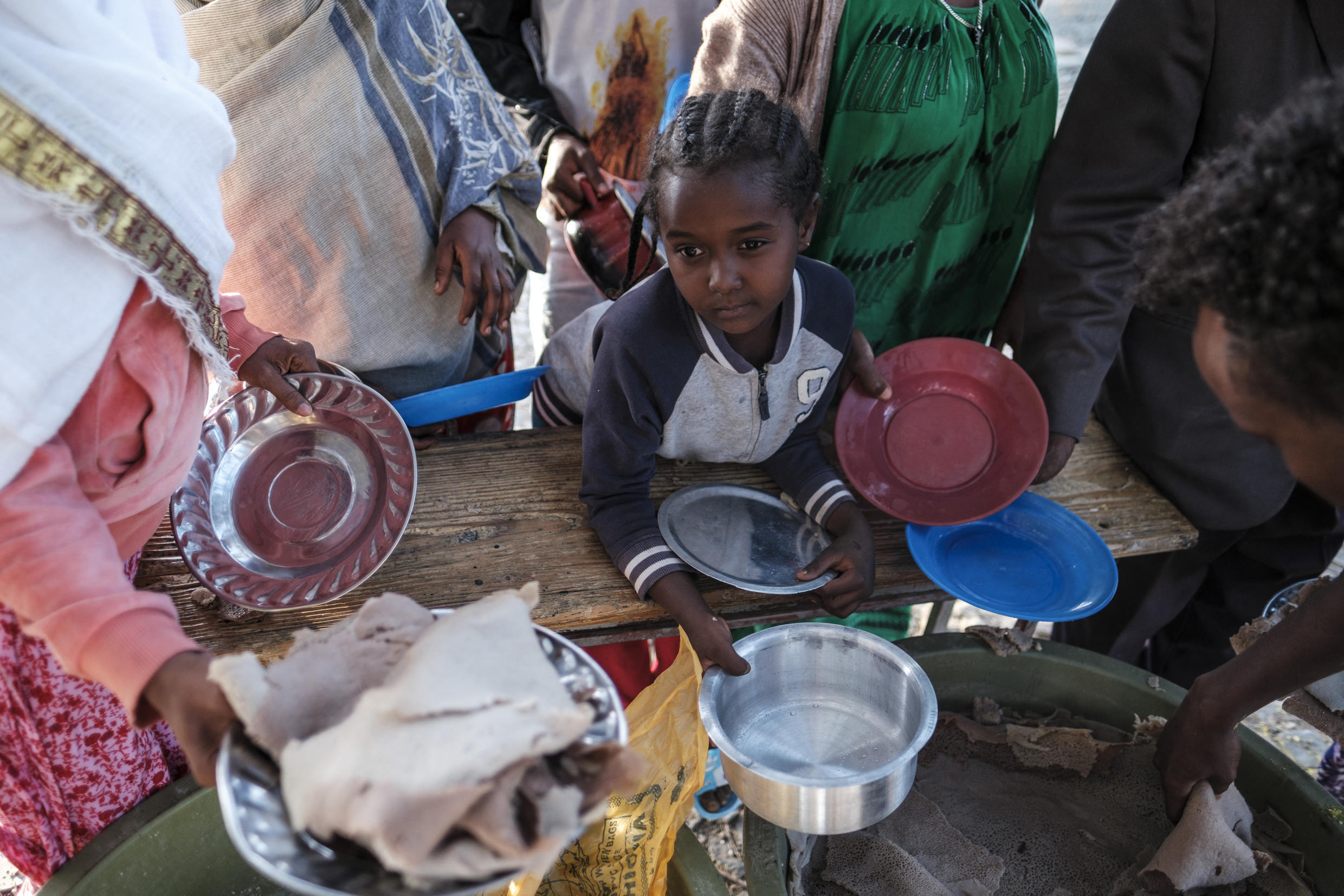 A child displaced from western Tigray waits to receive food at a school where they are sheltering in regional capital Mekelle, 24 February 2021.