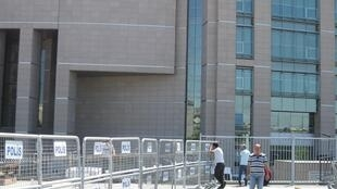 Relations of detained soldiers watch the Istanbul courthouse for signs of prisoners being freed or moved.