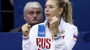 Russia's Maria Sharapova reacts as she watches compatriot Svetlana Kuznetsova play against Kiki Bertens of the Netherlands during their Fed Cup World Group tennis match in Moscow, in this February 7, 2016 file photo.