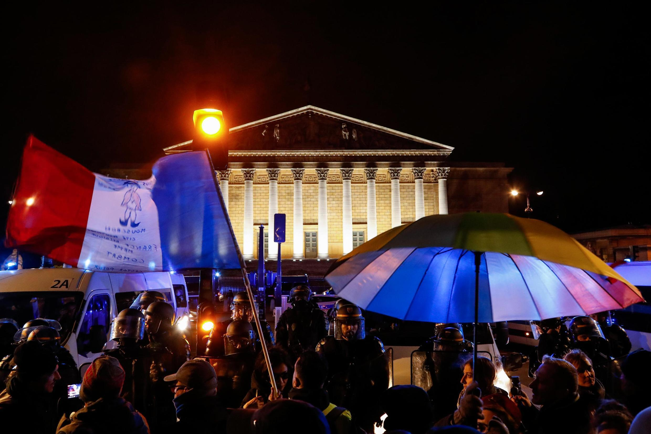 Demonstrators outside the French National Assembly protesting the government's decision to invoke the constitution's Article 49.3 to bypass parliament and pass the contested pension reform bill, 29 February 2020.