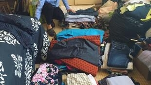 Kari Masson organising donated clothes ready for the clothing swap in Dakar