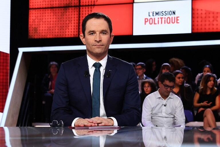 """French presidential election candidate for the left-wing Socialist Party (PS) Benoit Hamon poses prior to taking part in the show """"L'Emission politique"""" in Paris on March 9, 2017."""