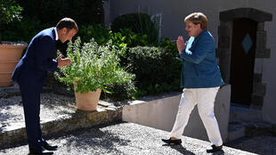 Macron welcomed Merkel with a Namaste-style greeting due to the coronavirus pandemic