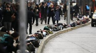 Demonstrators lie on the ground to represent people who disappeared or went missing during Augusto Pinochet's regime, Santiago, Chile, 10 September, 2013