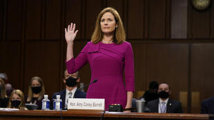 US Supreme Court nominee Amy Coney Barrett is sworn in during her confirmation hearing before the Senate Judiciary Committee in Washington.