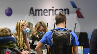 American Airlines says the company's fortunes will hinge largely on the return of business travelers