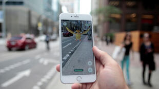 A Pidgey Pokemon on the screen of the Pokemon Go mobile app in Toronto, Canada