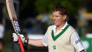 Ireland's Kevin O'Brien celebrates after scoring a hundred against Pakistan.
