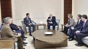 Президент Сирии Башар Асад на встрече с французскими парламентариями. 25 февраля 2015 года