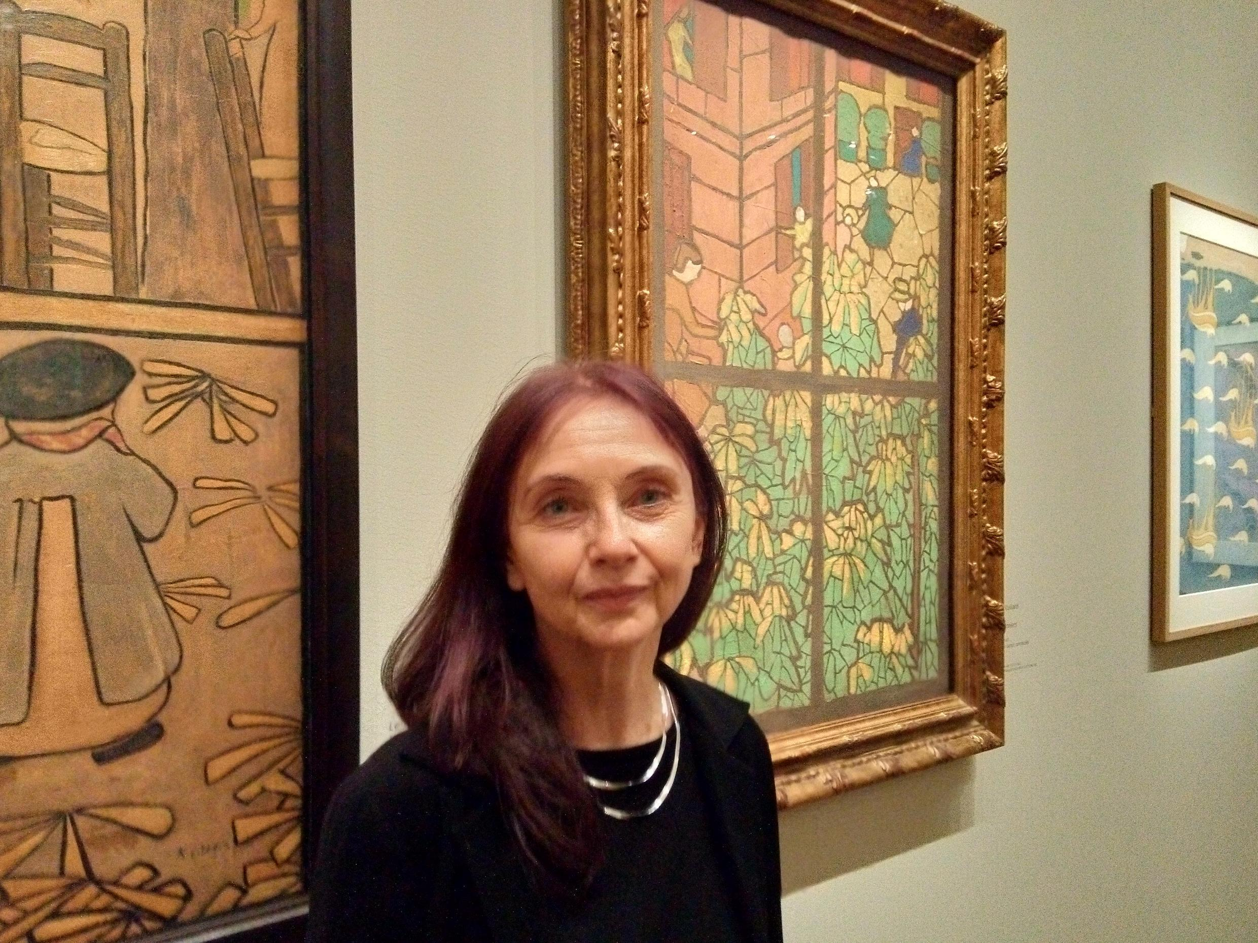 Curator Isabelle Cahn stands in front of a cartoon for a stained-glass window, Les Marroniers by Edouard Vuillard, from the The Eugene and Margaret McDermott Art Fund Inc at Dallas Museum of Art