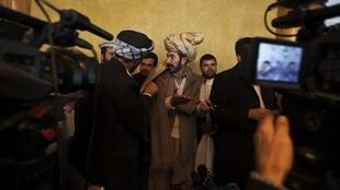 Members of Afghanistan's parliament speak among themselves at a hotel in Kabul