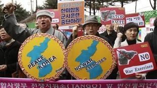 A rally against joint US-South Korea military drills in front of the command centre for the drills in Seongnam, near Seoul