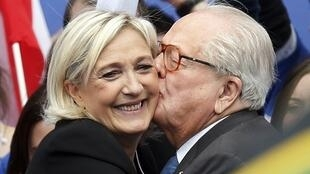 Family feeling - Jean-Marie Le Pen (R) kisses his daughter Marine at the Front National's 1 May parade in 2013