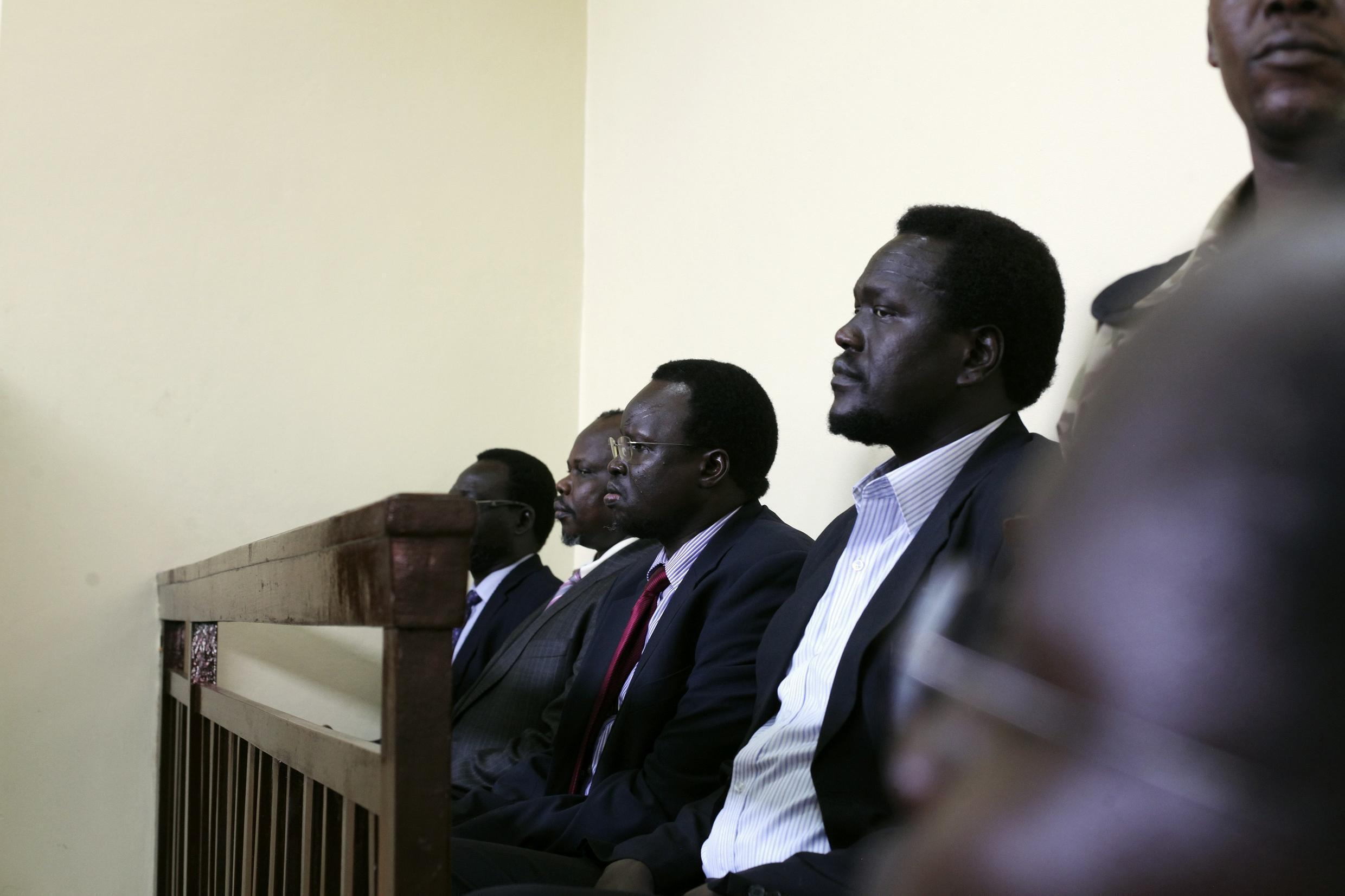 Former national security minister Oyai Deng Ajak, former secretary general of the SPLM party Pagan Amum, former deputy finance minister Majak D'Agoot and ex-ambassador to the US Ezekiel Gatkuoth, attend their court trial in Juba, 11 March 2014.