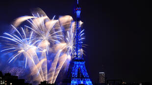 Fireworks at the Eiffel Tower during Bastille Day celebrations, July 14, 2018