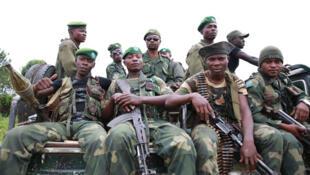 Le 3 décembre 2014 à Beni, Nord Kivu, en RD Congo: des soldats des Forces armées de la RDC en patrouille pour sécuriser la ville contre les attaques des groupes armés.