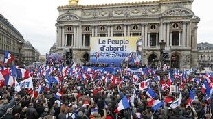 National Front supporters gather outside the Opéra in Paris on May Day.