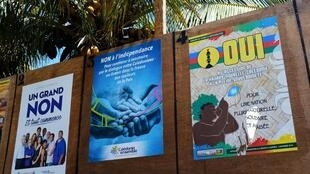 Boards with campaign posters by different political groups favoring or opposing New Caledonia's independence from France are seen during the referendum in Noumea, on the French overseas territory of New Caledonia, on November 4, 2018.