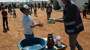 2020-04-15T122059Z_1816240106_RC205G9HAUMN_RTRMADP_3_HEALTH-CORONAVIRUS-SYRIA-CHILDREN