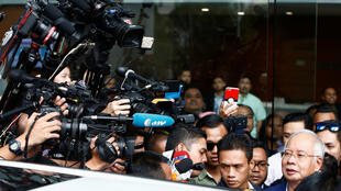 Malaysia's former prime minister Najib Razak speaks to journalists as he leaves after giving a statement to the Malaysian Anti-Corruption Commission (MACC) in Putrajaya, Malaysia May 22, 2018.