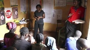 Evelyn Ojwang (front L) and Henry Owino teach children who trade sex for basic needs about HIV/Aids in Nairobi