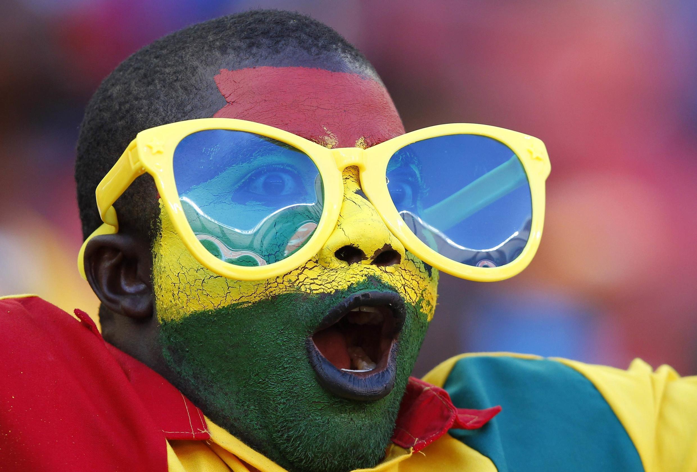Ghana fans cheer their team during their soccer match against Mali, 24 January, 2013