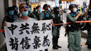 2020-07-01T104609Z_299593540_RC2AKH9MU1DH_RTRMADP_3_HONGKONG-PROTESTS-ANNIVERSARY