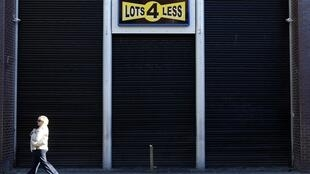 A pedestrian walks past a discount store in central Dublin, 14 November
