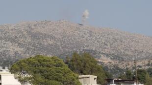 De la fumée s'élève sur les montagnes de Kfar Shouba, près de la frontière libano-israélienne, après un bombardement de l'armée israélienne, en 2014.