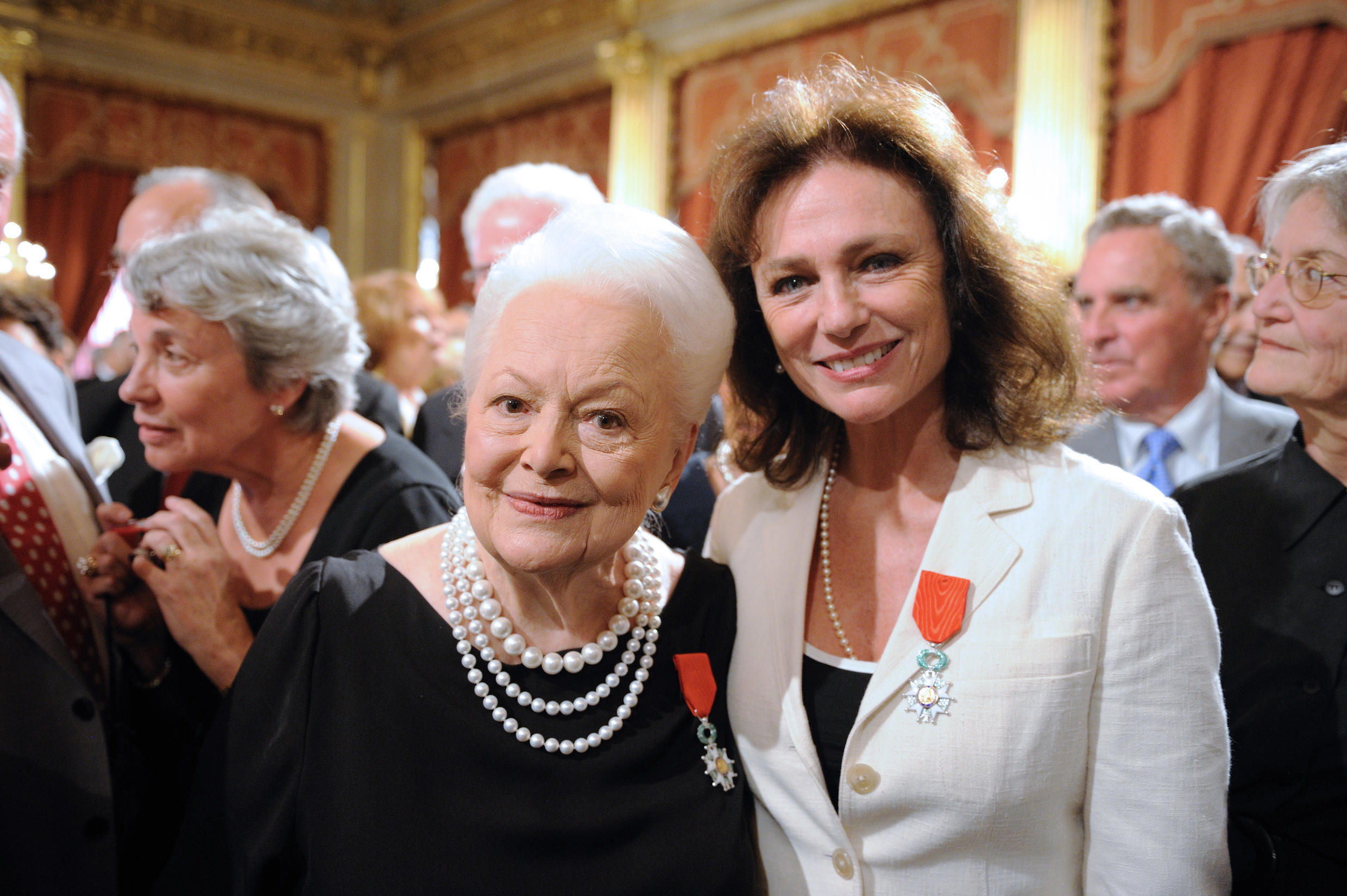 Olivia de Havilland and fellow actress Jacqueline Bisset receive their Chevalier of the Legion of Honour from president Nicolas Sarkozy at the Elysée Palace on 9 September 2010.