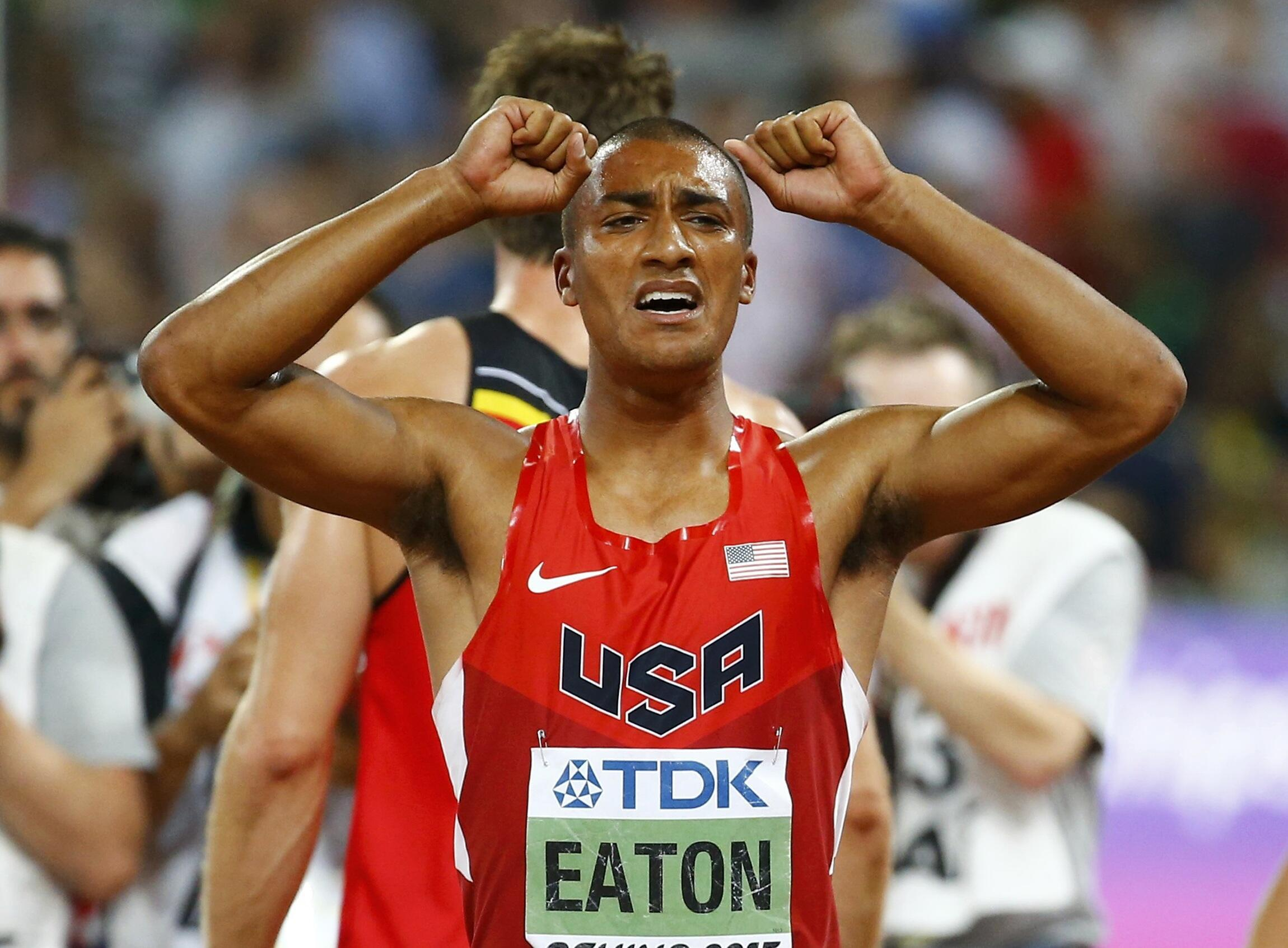 Ashton Eaton crosses the finish line in the 1500 metres decathlon at the 15th IAAF World Championships at the National Stadium in Beijing